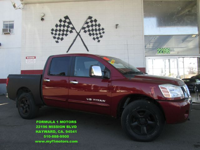 2005 NISSAN TITAN SE 4DR CREW CAB 4WD SB red abs - 4-wheel anti-theft system - alarm axle ratio
