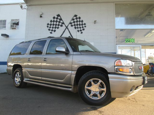 2003 GMC YUKON XL XL champagne 4wdawdabs brakesadjustable foot pedalsair conditioningalloy wh