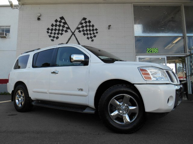 2005 NISSAN ARMADA SE 2WD white third row seating custom grill really nice suv this is the perfe