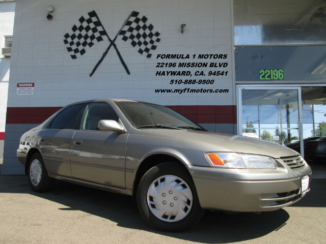 1998 TOYOTA CAMRY CE V6 4DR SEDAN beige this car is very affordable so if youre on a tight budge