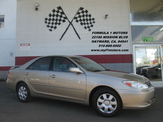 2004 TOYOTA CAMRY LE 4DR SEDAN gold cassette center console clock cruise control daytime runn