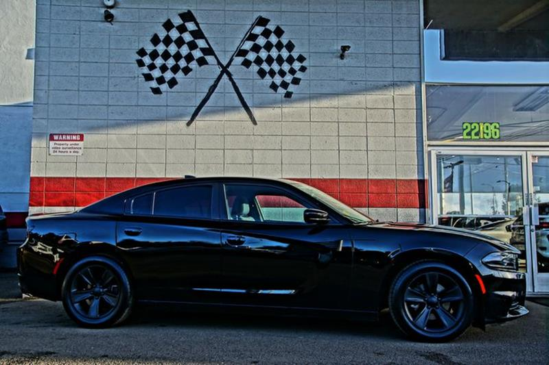 2016 DODGE CHARGER SXT 4DR SEDAN pitch black clearcoat our 2016 dodge charger sxt in pitch black