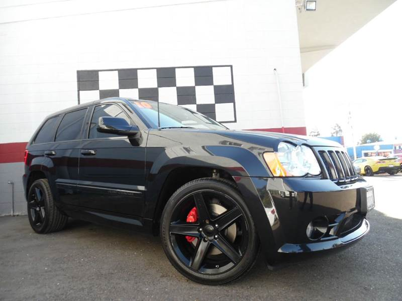 2010 JEEP GRAND CHEROKEE SRT8 4X4 4DR SUV black this srt8 jeep grand cherokee is not something you