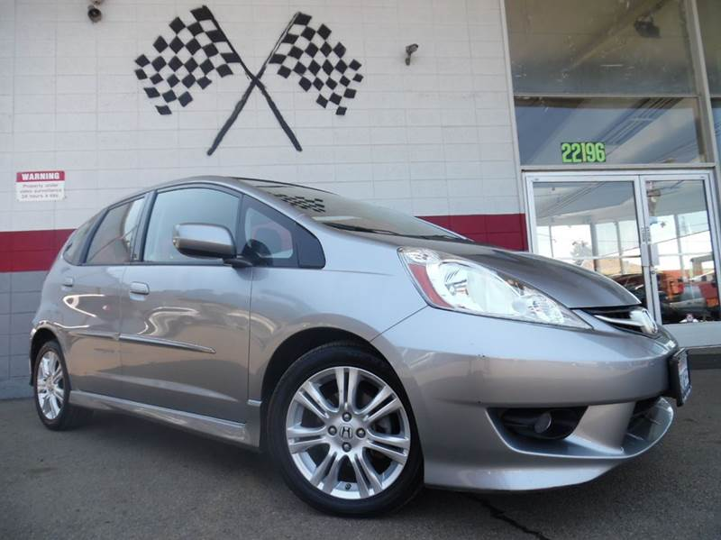 2009 HONDA FIT SPORT WNAVI HATCHBACK 5A WNAVI grey this is a very nice honda fit very dependab
