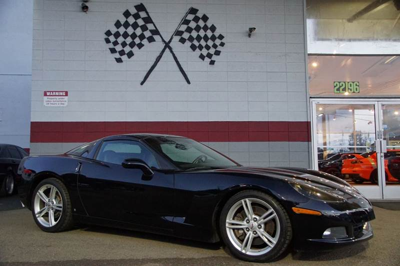 2009 CHEVROLET CORVETTE BASE 2DR COUPE W1LT black 2-stage unlocking doors abs - 4-wheel air fi