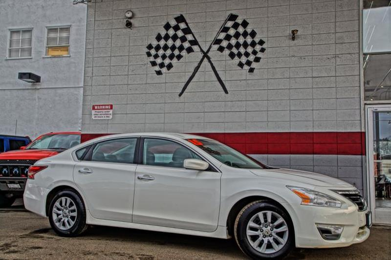 2015 NISSAN ALTIMA 25 4DR SEDAN solid white our 2015 nissan altima 25 s sedan is displayed in g