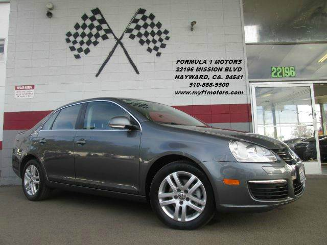 2009 VOLKSWAGEN JETTA TDI 4DR SEDAN 6M grey this is a very nice jetta super fun to drive its a