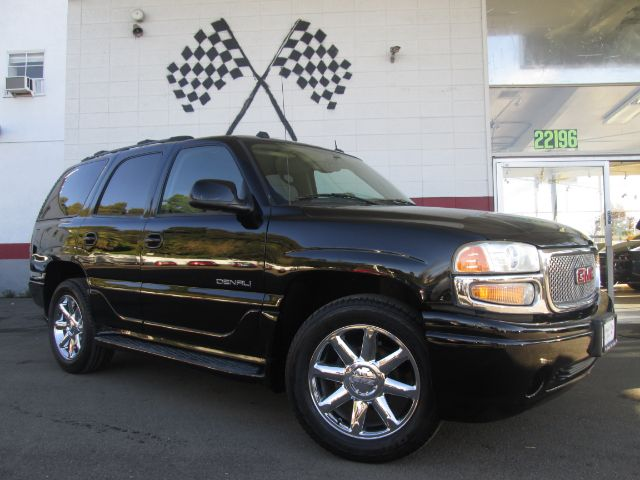 2004 GMC YUKON DENALI AWD 4DR SUV black abs - 4-wheel adjustable pedals - power anti-theft syste