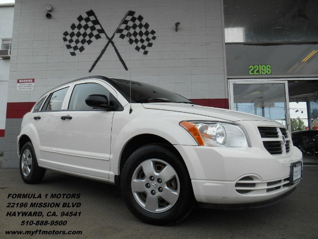 2008 DODGE CALIBER SE white this is a very nice and dependable car with excellent gas mileage its