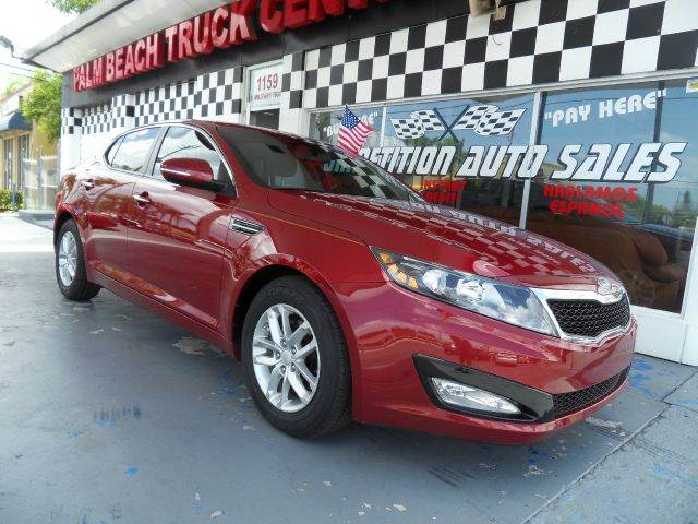2012 KIA OPTIMA LX 4DR SEDAN 6M red please contact competition auto sales at 888-865-0893   have