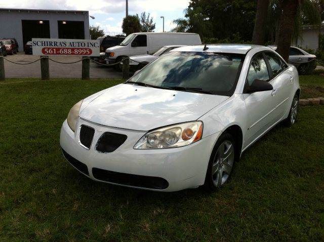 2009 PONTIAC G6 BASE 4DR SEDAN white please call less than 6000 at 888-865-0893   have bad cred