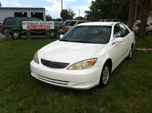 2002 TOYOTA CAMRY LE V6 4DR SEDAN white please call less than 6000 at 888-865-0893   have bad