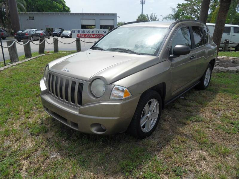2007 JEEP COMPASS SPORT 4DR SUV gold please call schirras auto at 888-865-0893  have bad credit