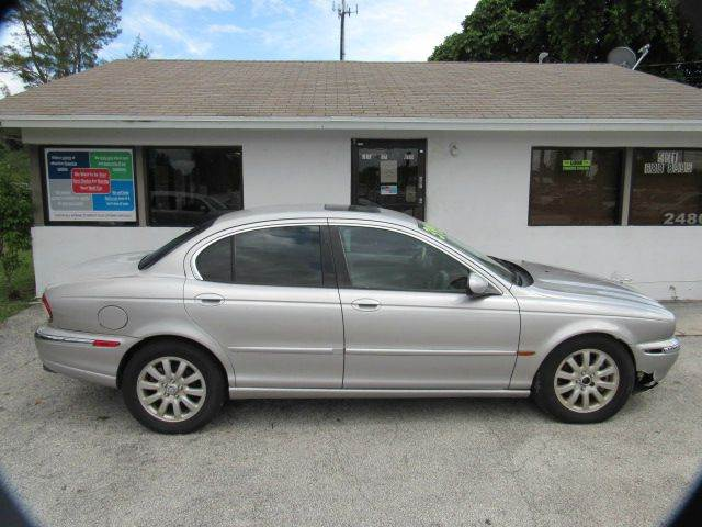 2003 JAGUAR X-TYPE 25 AWD 4DR SEDAN silver please call less than 6000 at 888-865-0893 have bad