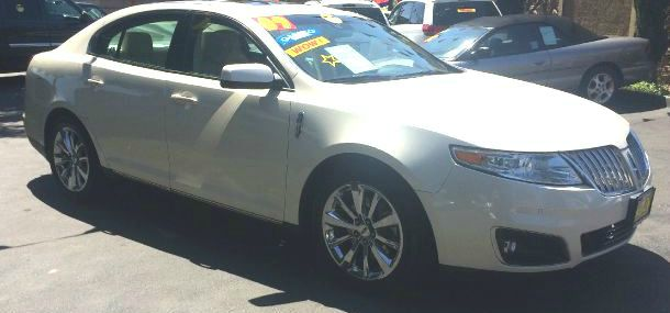 2009 LINCOLN MKS AWD white 4wdawdabs brakesair conditioningalloy wheelsamfm radioanti-brake