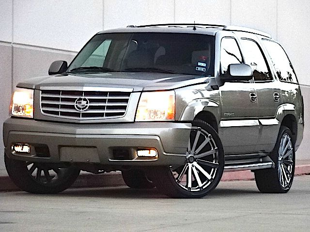2002 CADILLAC ESCALADE BASE AWD 4DR SUV gold the electronic components on this vehicle are in work