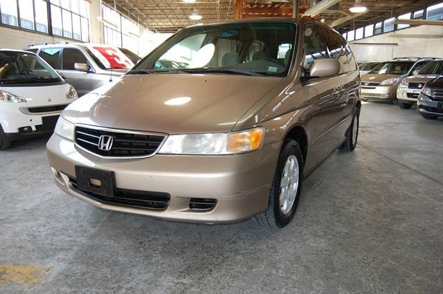 Gold Year 2003 Make Honda Model Odyssey Miles 138750