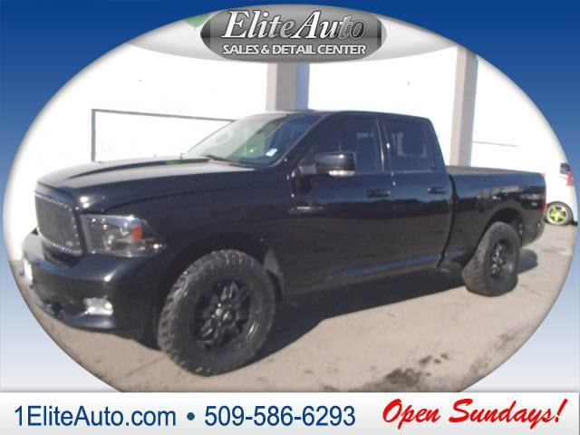 2012 RAM RAM PICKUP 1500 SPORT 4X4 4DR QUAD CAB 63 FT S black the ram stands out compared to ot