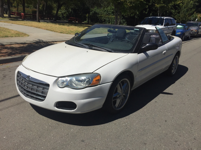 2004 CHRYSLER SEBRING BASE 2DR CONVERTIBLE unspecified center console clock convertible roof -
