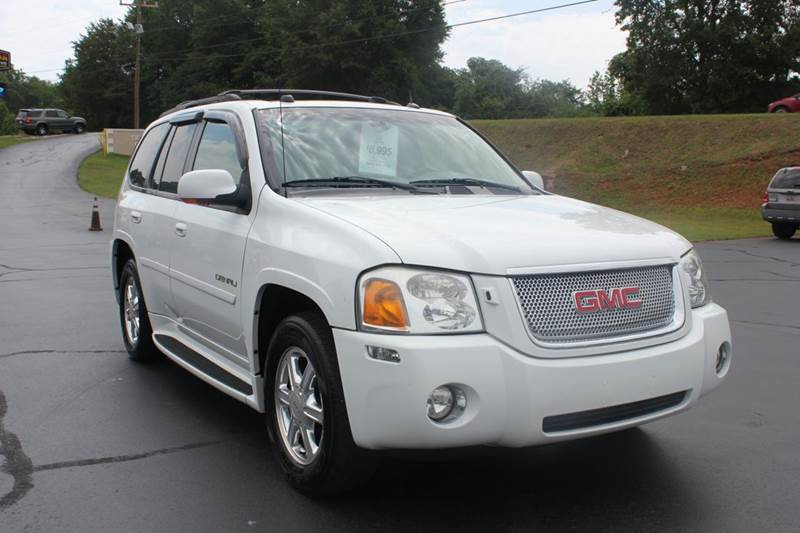 2005 GMC ENVOY DENALI 4WD 4DR SUV white this vehicle is located at our state of the art facility
