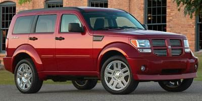 2010 DODGE NITRO 4WD 4DR SXT LTD AVAIL inferno red crystal pearl dodges nitro stands out for it