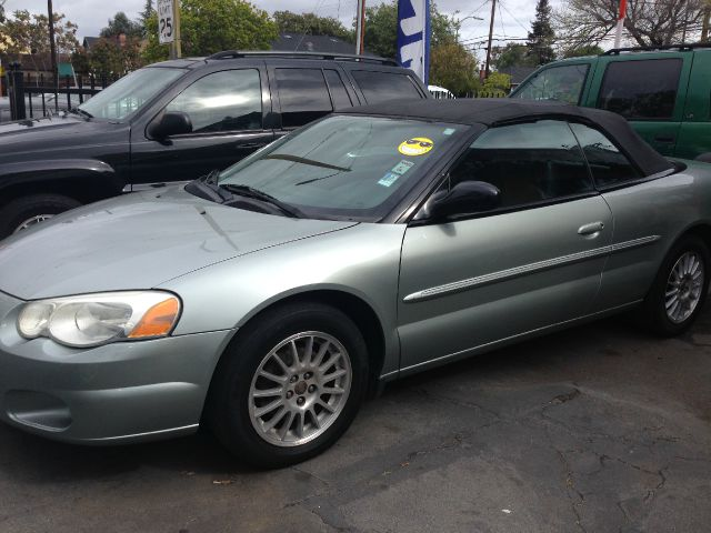 2006 CHRYSLER SEBRING TOURING CONVERTIBLE green air conditioningalloy wheelsamfm radioanti-bra