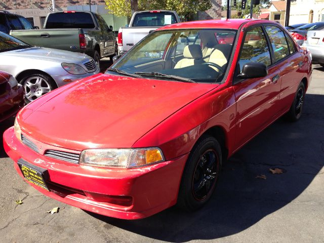 2000 MITSUBISHI MIRAGE DE 4-DOOR red actual miles the condition of the vehicles interior is avera