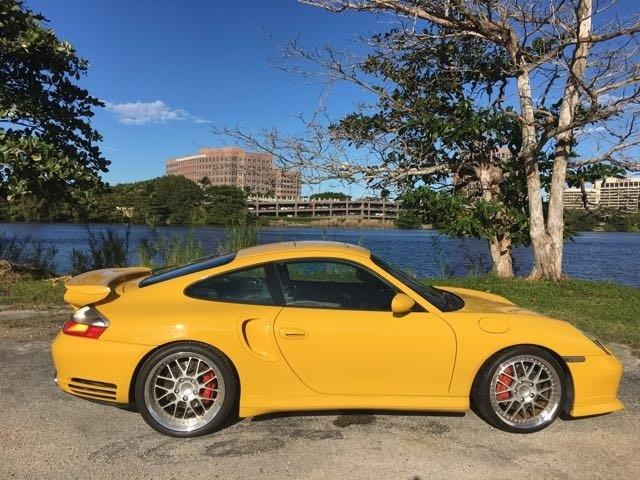 2003 PORSCHE 911 TURBO AWD 2DR COUPE yellow miami auto wholesale is a family owned and operated d