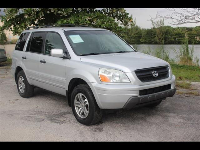 2005 HONDA PILOT EX 4WD 4DR SUV silver miami auto wholesale is a family owned and operated dealer