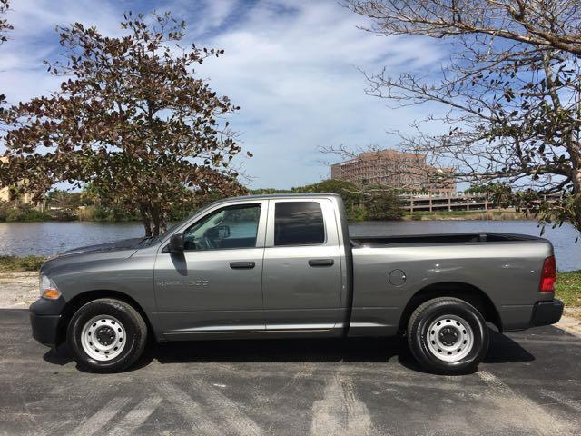 2012 RAM RAM PICKUP 1500 ST 4X2 4DR QUAD CAB 63 FT SB P gray miami auto wholesale is a family o