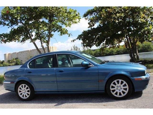 2002 JAGUAR X-TYPE 30 AWD 4DR SEDAN blue miami auto wholesale is a family owned and operated dea