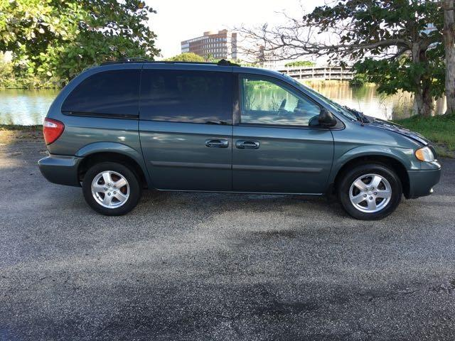 2005 DODGE CARAVAN SXT 4DR MINI VAN gray miami auto wholesale is a family owned and operated deal