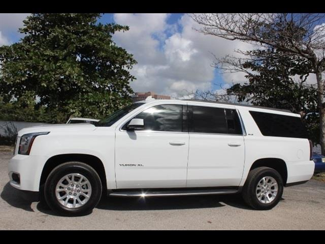 2015 GMC YUKON XL SLE 1500 4X2 4DR SUV white miami auto wholesale is a family owned and operated