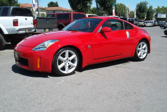 2003 NISSAN 350Z BASE red -this is a very clean vehicle with brand new tires and a clean title  -