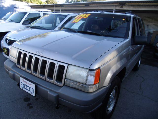 1997 JEEP GRAND CHEROKEE TSI gray 4wdawdabs brakesair conditioningalloy wheelsanti-brake syst