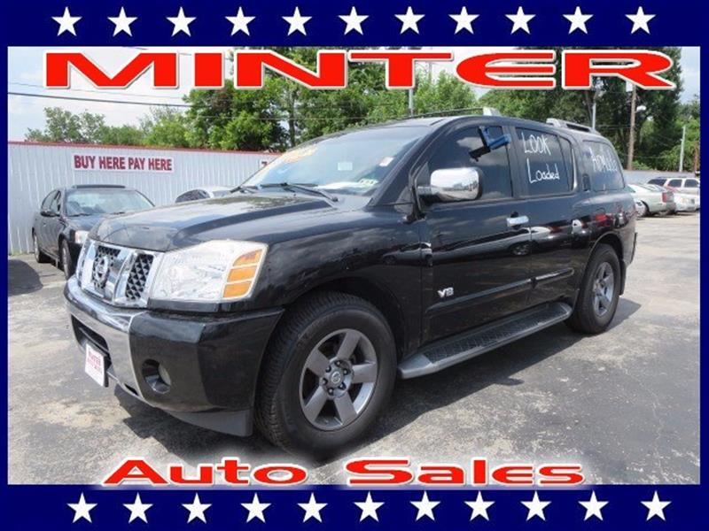 2005 NISSAN ARMADA LE 2WD black 14 cup holders4 12v dc pwr outlets2nd row bucket seats wre