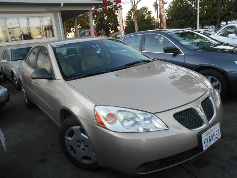 2007 PONTIAC G6 VALUE LEADER 4DR SEDAN W1SV gold 2-stage unlocking airbag deactivation - occupa