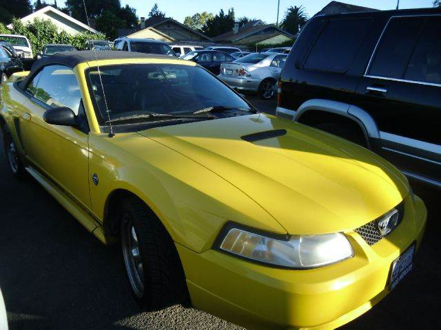 1999 FORD MUSTANG CONVERTIBLE yellow air conditioningalloy wheelsamfm radioanti-brake system
