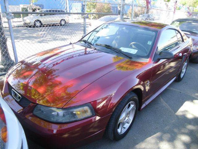 2003 FORD MUSTANG red cruise control front air conditioning front airbags - dual in-dash cd -