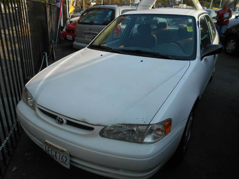 1999 TOYOTA COROLLA CE 4DR SEDAN white cassette center console clock daytime running lights f