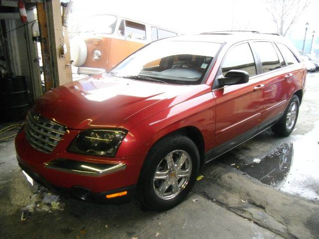 2004 CHRYSLER PACIFICA red air conditioning amfm radio wcd player cruise control driver and p