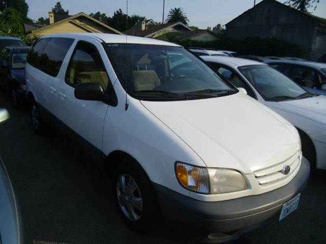 2001 TOYOTA SIENNA CE 4DR MINIVAN white abs - 4-wheel captain chairs 2 cassette clock dayti