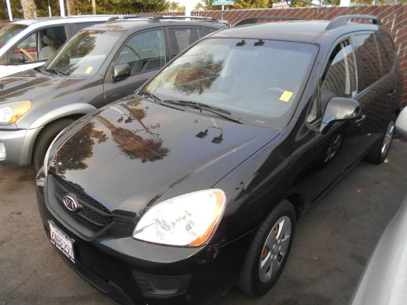 2009 KIA RONDO BASE 4DR CROSSOVER black 2-stage unlocking doors abs - 4-wheel active head restr