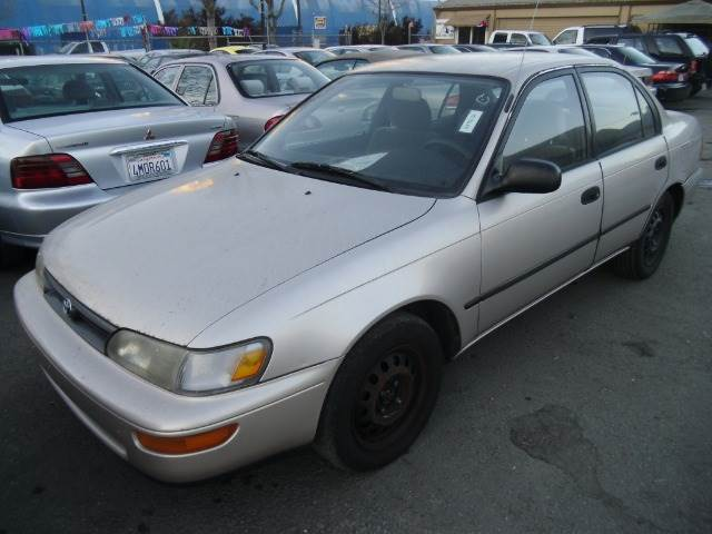 1994 TOYOTA COROLLA DX gold anti-brake system non-abs  4-wheel absbody style sedan 4-drcurb