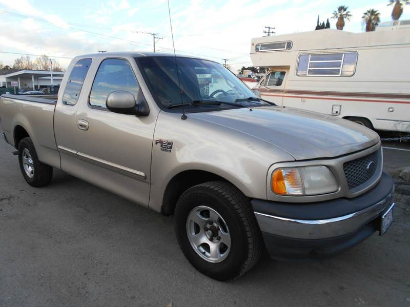2000 FORD F-150 WORK 4DR EXTENDED CAB LB gold abs - rear axle ratio - 308 bumper detail - rear