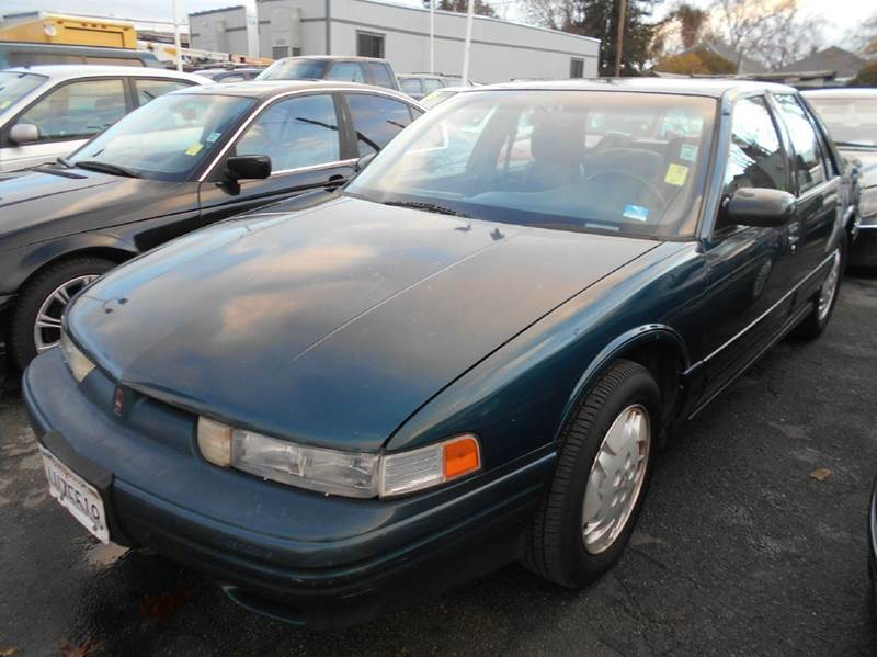 1995 OLDSMOBILE CUTLASS SUPREME S 4DR SEDAN green abs - 4-wheel anti-theft system - alarm exter