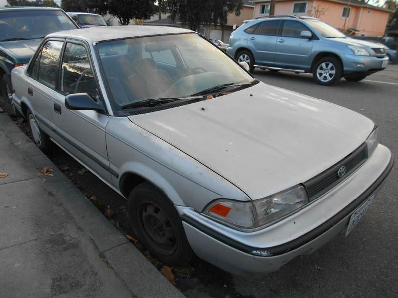1992 TOYOTA COROLLA DELUXE 4DR SEDAN silver front seat type - bucket multi-function remote - tru