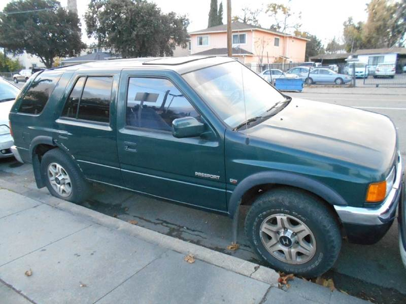 1997 HONDA PASSPORT LX 4DR SUV green abs - rear cassette cruise control front airbags - dual