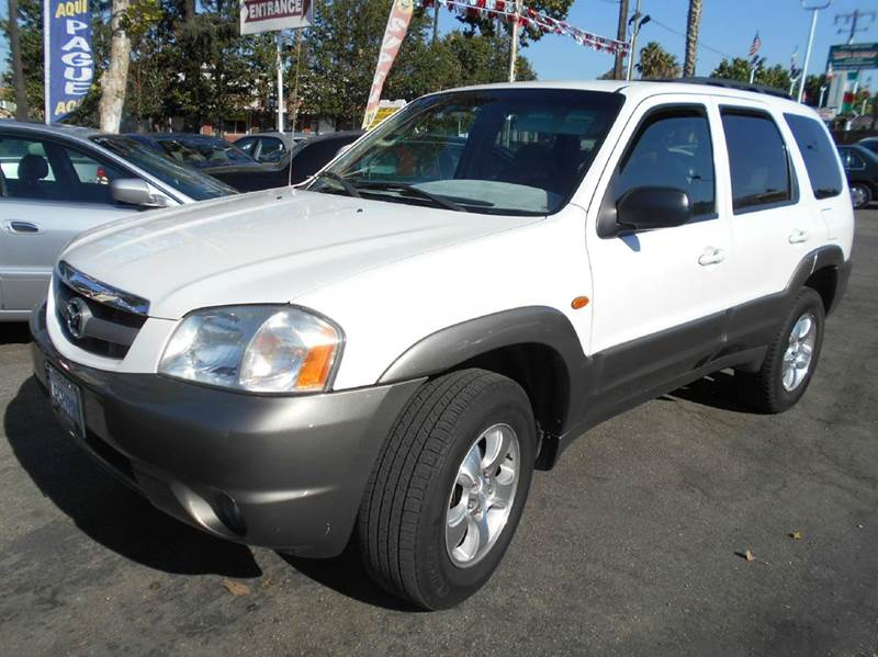 2001 MAZDA TRIBUTE 2WD 4DR SUV white anti-theft system - alarm center console clock exterior e