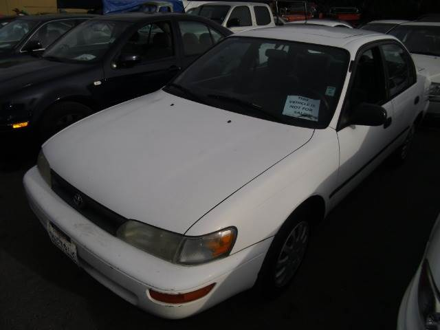 1995 TOYOTA COROLLA DX white anti-brake system non-abs  4-wheel absbody style sedan 4-drcurb